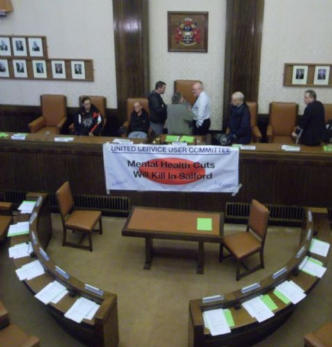 Click to view Matthew Finegan in Salford Council Chamber during occupation