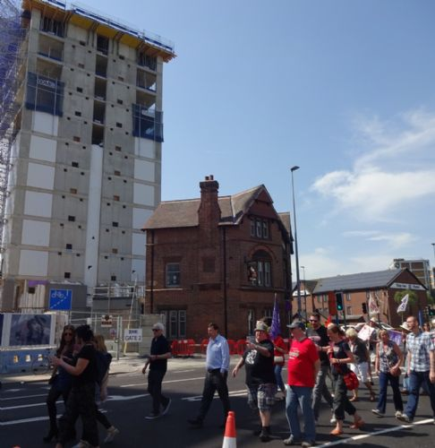 Click to view Salford May Day march goes past Fred Done apartments