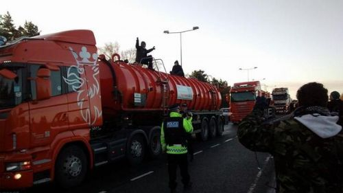 Click to view Salford Barton Moss campaigners lock on to lorries