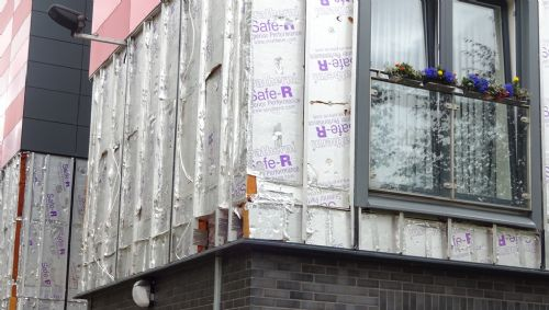 Click to view Salford insulation left out in the rain in Pendleton