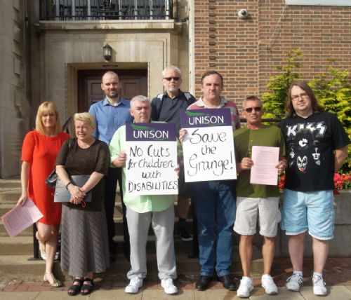 Click to view SAVE THE GRANGE CAMPAIGNERS OUTSIDE SALFORD COUNCIL MEETING