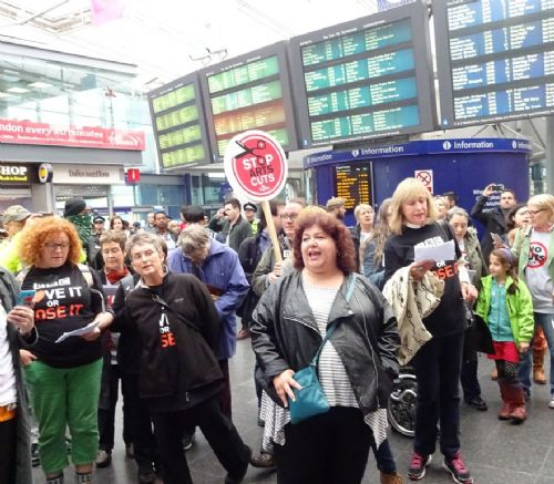 Click to view Tories Not Welcome flash mob at Piccadilly Station