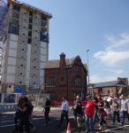 Salford May Day march goes past Fred Done apartments