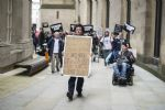 Disabled People Against Cuts wall of noise protest Manchester Conservative Party Conference